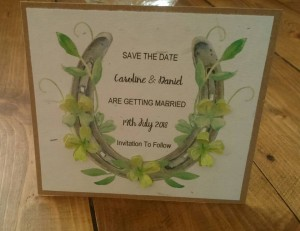 Horse shoe and clover on grass paper save the date